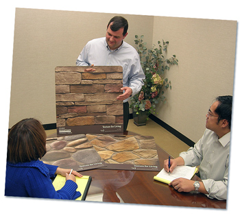 A client showing home product samples to the Walt Denny Inc. team